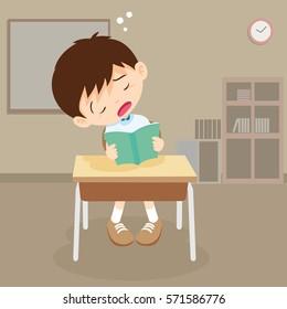 student boy sleeping in classroom. pupil sleepy on reading time.