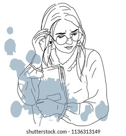 student girl in round glasses with book and ink blue splash