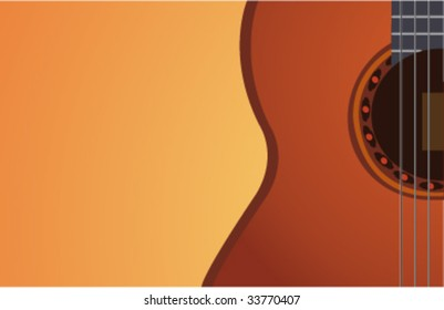Stylish acoustic guitar on orange background
