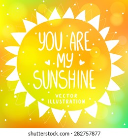 stylish and beautiful orange background with sun from triangles and text-you are my sunshine