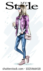Stylish beautiful young woman with coffee mug. Hand drawn fashion woman. Cute girl with blond hair. Sketch.