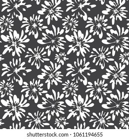 Stylish hand drawn floral seamless pattern. Black and white abstract free hand sketch flowers. Vector botanical decorative background design for fabric textile ditsy print, wallpaper, wrapping paper.