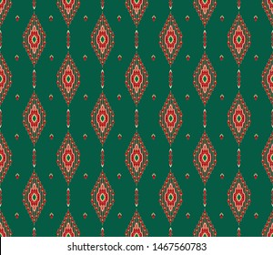 Stylized Central Asian ikat pattern in green and red colors. Seamless vector.