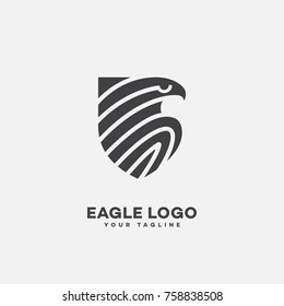 Stylized eagle logo template design with a shield. Vector illustration.