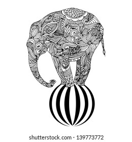 Stylized fantasy patterned elephant standing on a ball. Hand drawn vector illustration.
