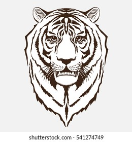 The stylized image of a tiger's head. For use in logos, promotional images. tattoos. Vector illustration.