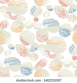 Stylized ovals and ellipses seamless pattern. Abstract texture with contrasting pebbles silhouettes on white background. Beige ellipses with multicolored scribbles. Wrapping paper, textile print