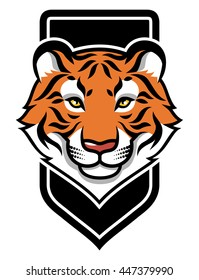 Stylized tiger's head on black shield. Color vector illustration  isolated on white