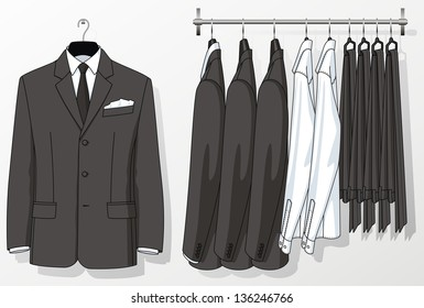 The suit for the man hangs on a hanger