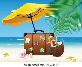 Suitcase and coconut cocktail on a beach