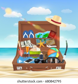 suitcase open with beach travel object on beach