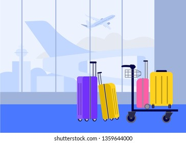 Suitcases at the airport in the arrival and departure hall on the background of flying aircraft