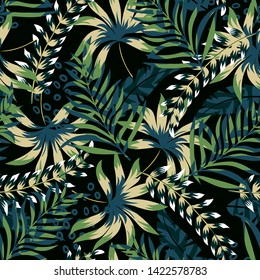 Summer bright original seamless pattern with tropical leaves and plants on a black background. Vector design. Jung print. Floral background. Printing and textiles.