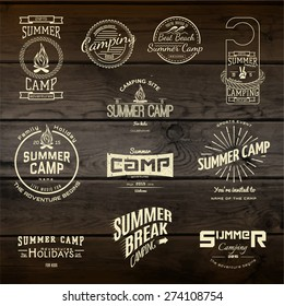 Summer camp badges logos and labels for any use,  on wooden background texture.