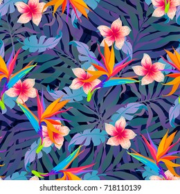 Summer exotic palm leaves and flowers background. Vector tropical abstract seamless pattern. Plant flower nature wallpaper