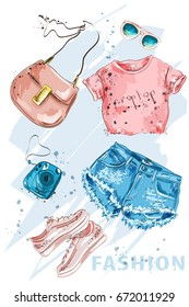 Summer Fashion outfit. Stylish trendy clothing: shorts, crop top, bag, shoes, sunglasses and photo-camera. Fashion girl clothes set, accessories. Woman's fashion look. Sketch. Vector illustration.