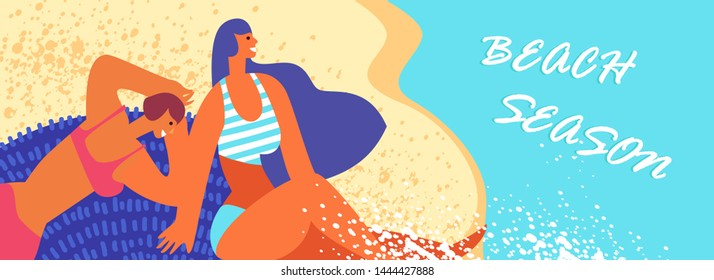 Summer holiday. Couple young female lying on the sand on a tropical beach. Concept trip to the seaside, rest, sea travel
