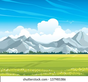 Summer landscape with green flowering meadow and gray mountains on a blue sky background with cumulus clouds