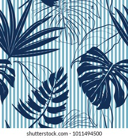 Summer Navy blue tropical forest leaves bright mood on sky blue stripe seamless pattern for fashoin fabric ,wallpaper book , card and etc
