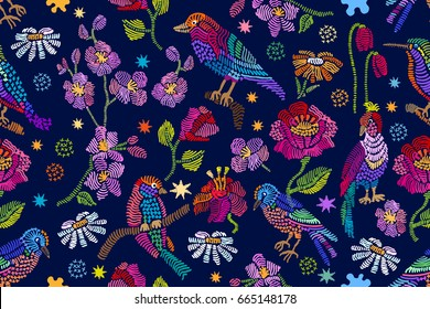 Summer night garden. Vintage birds, chamomiles, poppies and tulips on dark blue background. Stylized embroidered texture. Folk art textile collection.