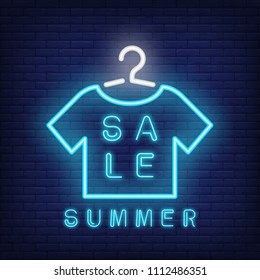 Summer sale neon text with t-shirt on hanger. Seasonal offer or sale advertisement design. Night bright neon sign, colorful billboard, light banner. Vector illustration in neon style.