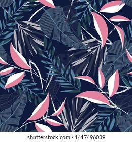 Summer seamless pattern with tropical leaves and plants on a dark blue background. Vector design. Jungle print. Textiles and printing. Floral background.