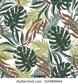 Summer seamless tropical pattern with bright green and red plants and leaves on a light background.  Summer colorful Hawaiian seamless pattern with tropical plants. Exotic tropics. Summer.