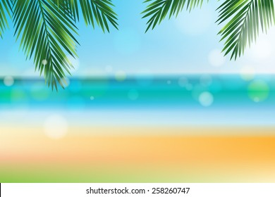 Summer time at the beach with coconut leaf on top and bokeh effect