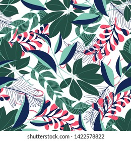 Summer trend seamless pattern with tropical leaves and plants on white background. Vector design. Jung print. Floral background. Printing and textiles.