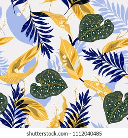 Summer and trendy tropical leaves. Seamless graphic design with palms leaves and flowers. Fashion,fabric and all prints on stylishlight blue background