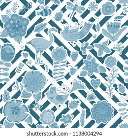 Summer tropic flowers pattern with striped seamless pattern on the background in cold blue colors.