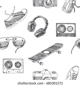 Summer vacation. Vector seamless pattern with skateboard, sunglasses, headphones, cassette, sneakers and photo camera. Sketch style hand drawn illustration of street accessories isolated on white.