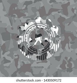 sumo deadlift icon on grey camouflaged texture