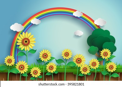 Sunflower field with blue sky and rainbow, paper art.