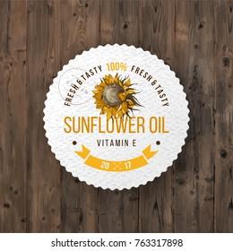 Sunflower oil emblem over wooden background
