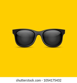 Sunglasses isolated with yellow background