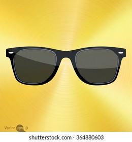 Sunglasses on brushed Golden background