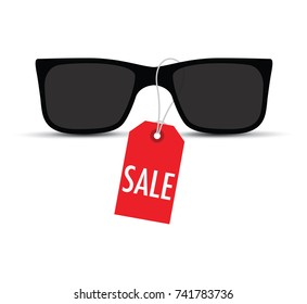 sunglasses with a sale tag