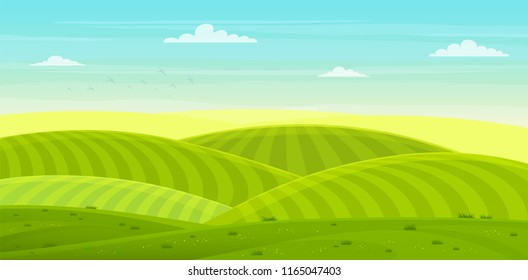 Sunny rural landscape with hills and fields. Summer green hills, meadows and fields with a dawn, blue sky in the clouds.
