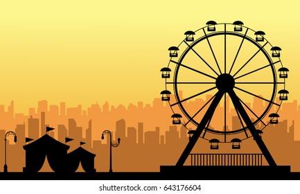 At sunset amusement park scenery silhouette
