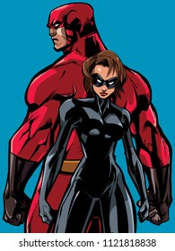 Superhero couple, standing back to back, ready for battle.