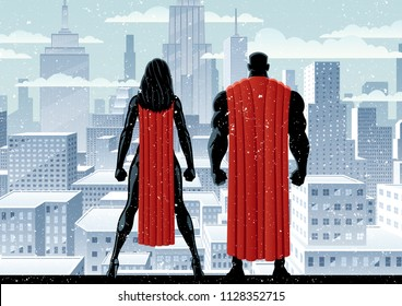 Superhero couple watching over the city in the snow.