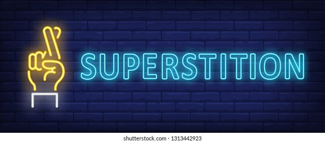 Superstition neon sign. Hand with two fingers crossed on brick wall background. Vector illustration in neon style for banners, billboards, posters