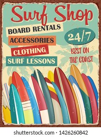 Surf Board Shop vintage metal sign with surfboard lines up on  beach.