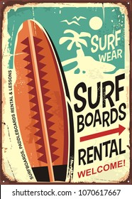 Surfboards rentals retro tin sign design on old rusty background. Tropical paradise poster. Commercial sign for surfing and beach activities.