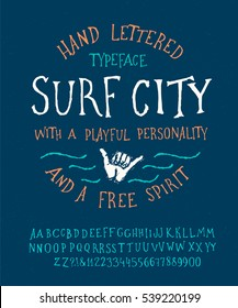 Surfing Summer Font. Hand Made Typeface 'Surf City'. Custom handwritten surfers alphabet. Original Letters and Numbers. Vintage retro textured hand drawn type for shirt logo print. Vector illustration