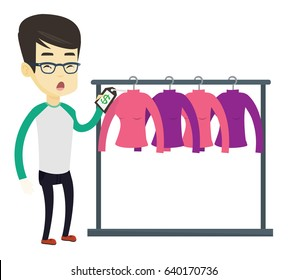 Surprised asian man looking at price tag in clothing store. Man shocked by price tag in clothing store. Amazed man staring at price tag. Vector flat design illustration isolated on white background.