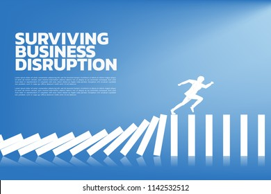 surviving business disruption. Silhouette of businessman running from domino collapse. Concept of business industry disrupt