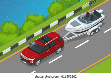 The SUV drives a motor boat along the road along the sea. Summer vacation on the sea and motor boat rides.