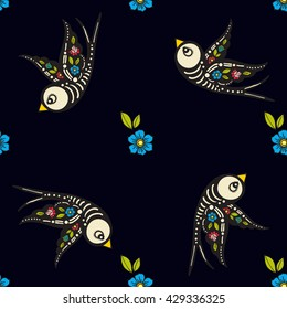 Swallows and flowers in an old-style tattoo. The day of the Dead. A seamless pattern on a black background. Texture for vintage scrapbooking, wrapping paper, textiles, web page,fashion